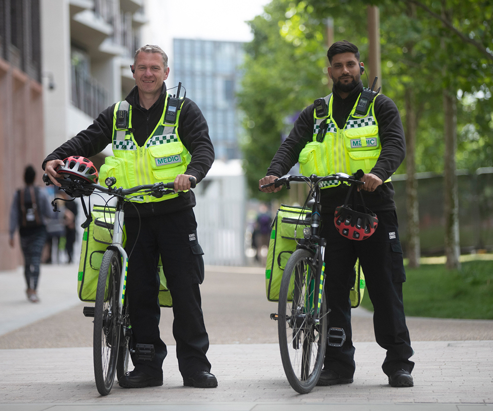 two security professionals holding bike